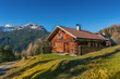Leinwandbild Motiv old wooden hut cabin in mountain alps at rural fall landscape