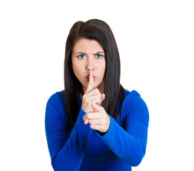 woman placing finger on lips with shhh sign symbol