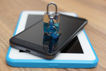 Padlock on smart phone and tablet computer. Safety & security on