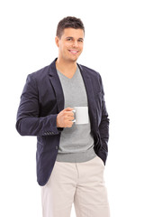 Elegant man holding a coffee mug