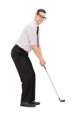 Full length portrait of a man playing golf