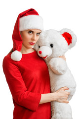 Woman in red santa hat holding white toy bear