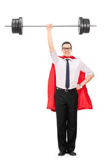 Full length portrait of a superhero holding a heavy weight