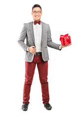 Full length portrait of an elegant man holding a present
