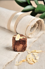 Vegetarian candy with nuts on linen napkin