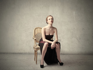 Classy woman sitting on a chair