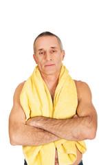 Mature man holding towel around neck