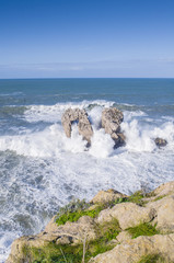 Big waves crashing against the rocks