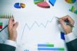 businessman observing a chart with an upward trend