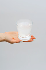 Glass with water and effervescent tablet