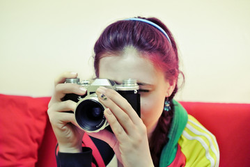 Pretty young woman with a camera