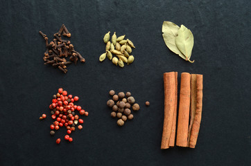 Mix of spices on a stone background