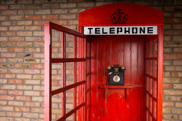 Old Fashioned Red Telephone Booth with Open Door