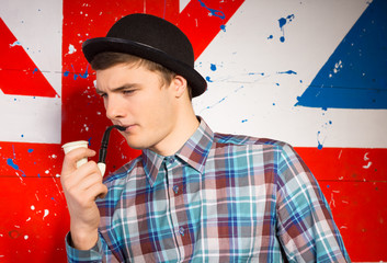Typical English gentleman in a bowler hat and pipe