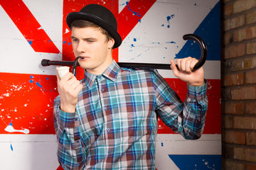 Young Man Posing with Smoking Pipe and Cane