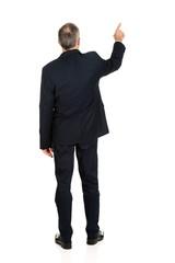 Full length businessman pointing upwards