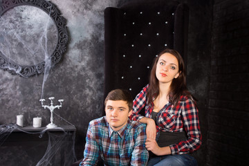 Close Up of Couple in Creepy High Back Chair