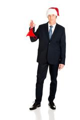 Santa businessman with female thongs on finger