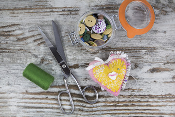 Sewing tools in a wooden background