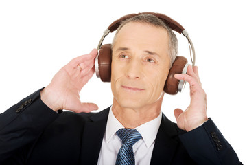 Portrait of businessman with big headphones