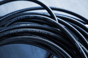Bundle of Black plastic cable channel