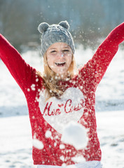 Laughing beautiful girl in winter time in snow. Arms up
