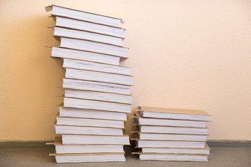 two stacks of white paper near wall