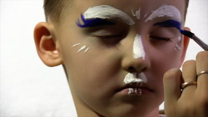 boy paint on his face paints