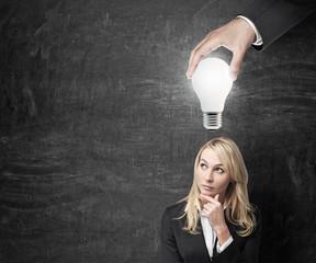 hand holding bulb