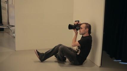 Young man work in photo studio
