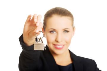 Businesswoman giving house keys