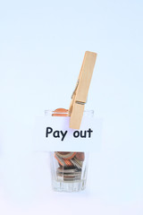 coin in glass and pay out tag