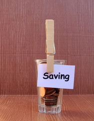 coin in glass and saving tag 2