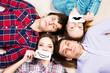 four young men lie together