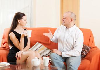 man talking to his pretty woman