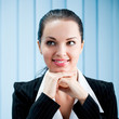 Closeup of thinking businesswoman at office