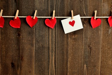Red heart message card and heart with clothes pin