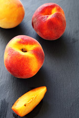 Juicy peaches on a gray  background