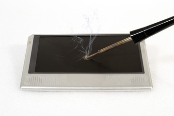 Hot soldering iron in the tablet screen