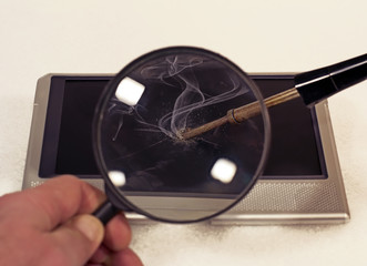 Soldering iron with tablet through a magnifying glass
