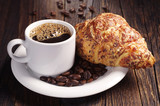 Cup of coffee and croissant with cheese - 75480414