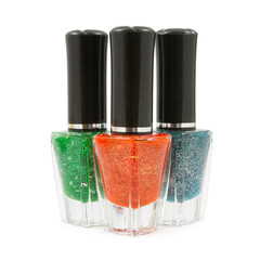 Green red  blue nail polish bottle on white background