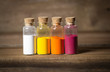 Glass bottles filled with coloured powder - 75480802