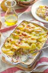 Potato gratin with bacon and cheese