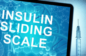 the words insulin sliding scale on a tablet with syringe