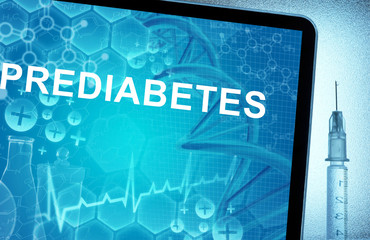 the word prediabetes on a tablet with syringe