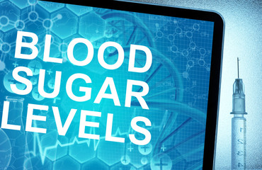 the words  blood sugar levels on a tablet with syringe