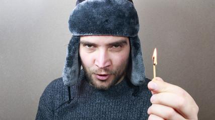 Man hand holding a match.