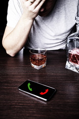 Drunk man in front of a mobile phone