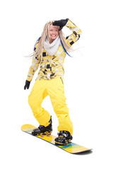 Woman with dreadlocks standing on snowboard